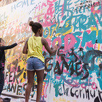 Young person painting mural